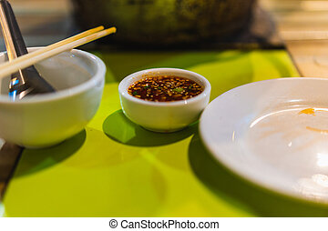 spicy sauce with chilli in Grill pork restaurant, thai food