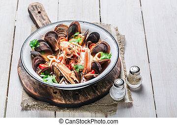 Spicy seafood soup with langoustines and mussels