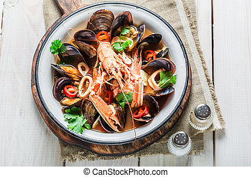 Spicy seafood soup with mix of shellfish
