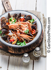 Spicy seafood soup with mussels and shrimps