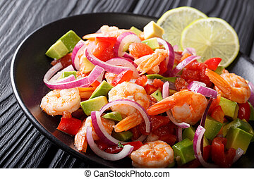Spicy shrimp ceviche with vegetable salsa close-up on a...