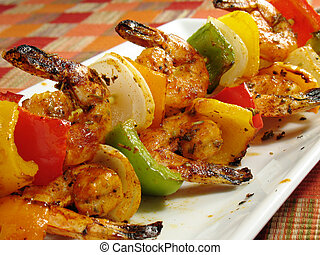 Spicy Shrimp Kabobs - A platter of spicy shrimp kebabs with...