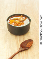 Spicy sour soup vegetable on wooden background