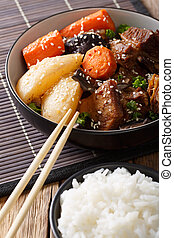 Spicy stewed ribs with vegetables, sesame and rice garnish...