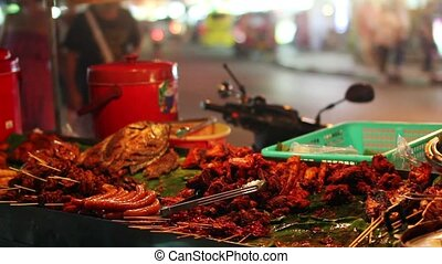 Spicy Thai foods on street at night