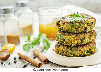 spicy vegan curry burgers with millet, chickpeas and herbs. ...