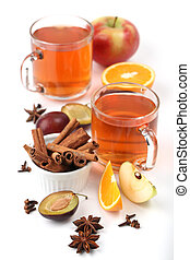 Spicy winter hot drink with oranges, apples, plums, cinnamon...