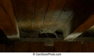Spider Web in the Attic - Waving spider web on the dusty...