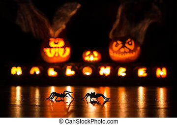 Spiders with Halloween pumpkins - Two spiders crawling in...