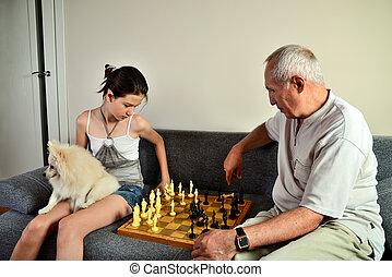 spielende , enkelin, opa, hund, schach