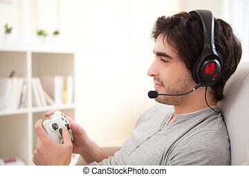 spielende , video, junger mann, attraktive, spiele, sofa, online
