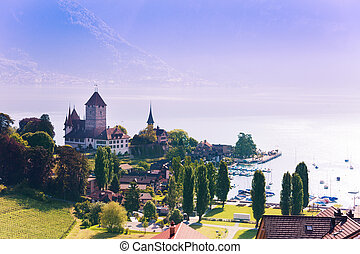 Spiez castle on Thun lake panorama in Switzerland, view from train station