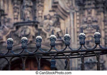 spiked fence in front of the cathedral