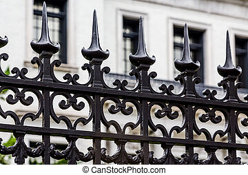 Spiked Iron Fence by White Building
