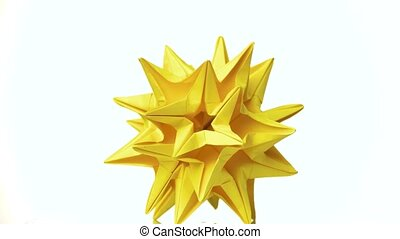 Spiked yellow dodecahedron. Stellated dodecahedron origami...