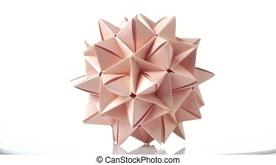 Spiky ball origami figure. Beautiful origami model made from...