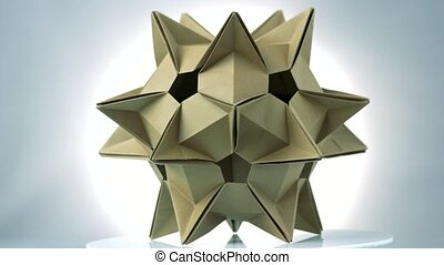 Spiky origami model of brown color. Astronomical body made...