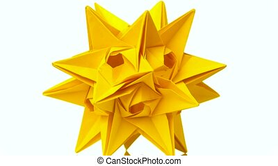 Spiky origami model of yellow color. Yellow star origami...