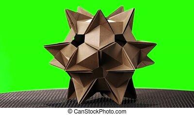 Spiky origami model on green screen. Brown cosmic satellite...