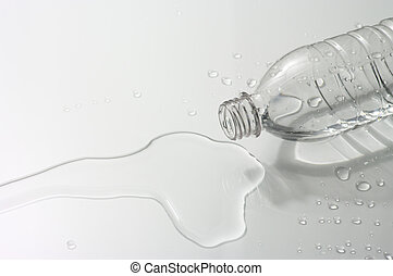 Spilled water and plastic bottle on white background.