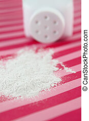 Spilled baby powder - Spilled baby scented powder on striped...