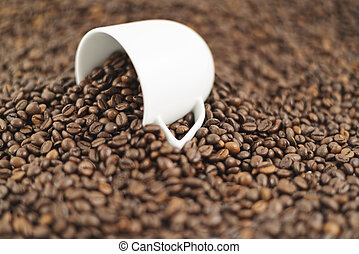 Spilled out of cup coffee beans