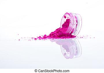 spilled pink makeup powder