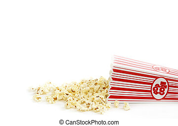A bucket of popcorn has spilled out.