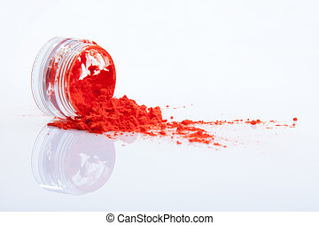 spilled red makeup powder