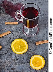 Spilled red mulled wine and orange
