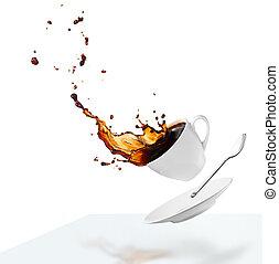 cup of spilling black coffee creating splash