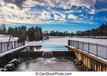 Spillway at Kiwanis Lake, seen during the winter in York,...