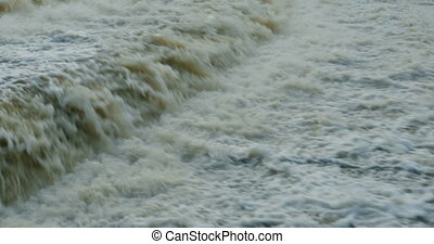 spillway boiling white water close to, camera in motion