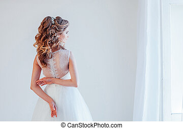 spin the bride in a wedding dress in a white room