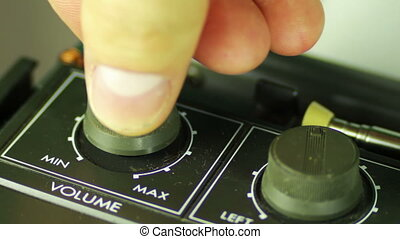 Spin the Volume Control on the Tape Recorder.