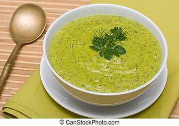 Spinach cream soup in white bowl