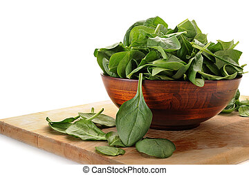 Image of spinach in bowl with white background