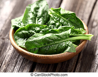 Spinach in a wooden plate