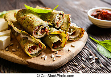 Spinach pancakes stuffed with Feta, curd, sun dried tomato and sunflower seeds