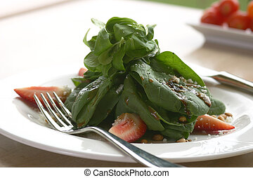 Spinach Salad - Spinach salad. Shallow DOF.