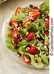 Spinach salad with strawberries, nuts and cranberries