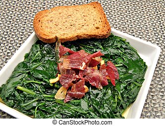 Spinach stew with ham and toast