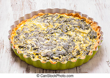 Spinach Tart - Whole Spinach Tart on the table close up