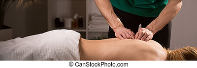 Spinal column mobilization - Woman in beauty resort during...