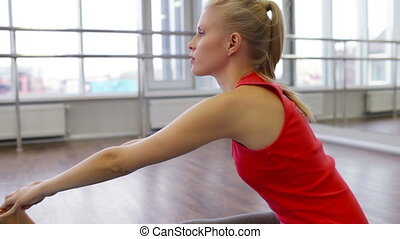 Spinal Twist - Fit yogi doing a spinal twist then sitting in...