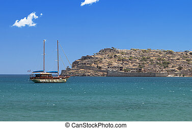 Spinalonga island and fortress at Plaka, Elounda bay of...
