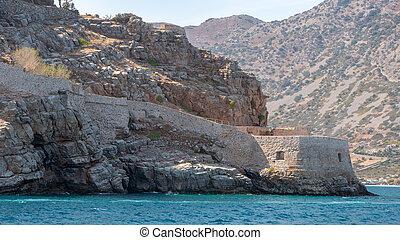 Spinalonga Island, Crete with Plaka village in background -...