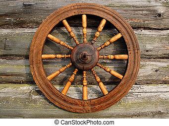 spinnend wiel, op, de, logboek, woning, muur