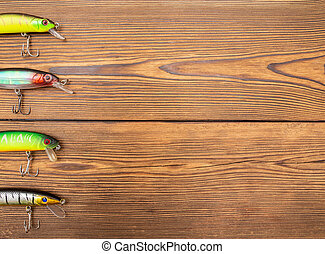 Spinner for fishing on a wooden background. Fishing equipment, copy space
