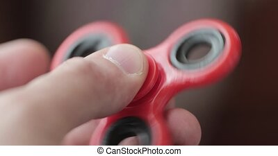 spinner in the hands of a close-up. - spinner in the hands...